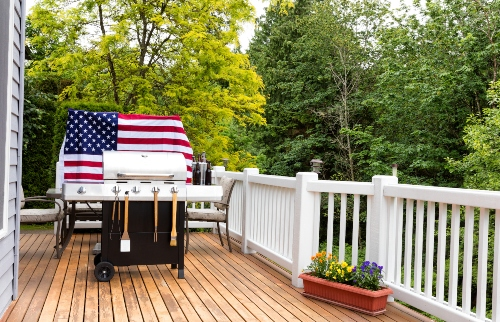 A U.S. flag stands proudly behind a BBQ grill ready for Memorial Day weekend.